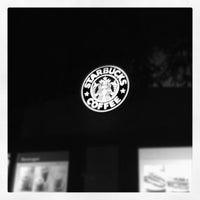 Photo taken at Starbucks by Ayako Y. on 11/24/2011