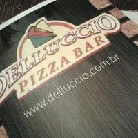 Photo taken at Delluccio Pizza Bar by Amanda on 9/9/2012