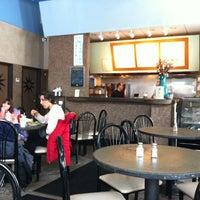 Photo taken at Apollo Cafe by Daniel S. on 3/6/2011