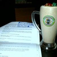 Photo taken at Coffee Toffee Origin by Regina J. on 12/16/2011