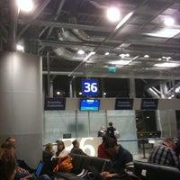 Photo taken at Gate 50 by Boris T. on 3/7/2011
