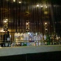 Photo taken at Steel Restaurant & Lounge by Benjamin C. on 9/9/2011