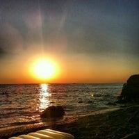 Photo taken at Saronida Beach by Christos L. on 8/5/2012