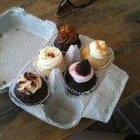 Photo taken at Enjoy Cupcakes by Dennis F. on 4/21/2012
