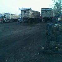 Photo taken at Tramell trucking yard by Michael J. W. on 3/13/2012