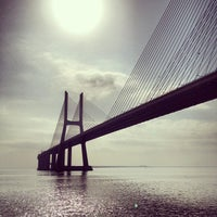 Photo taken at Ponte Vasco da Gama by Andre R. on 9/7/2012
