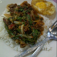 Photo taken at ร้านป้ายชมพู by Kor K. on 3/15/2012
