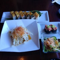 Photo taken at Kanpai Japanese Sushi Bar & Grill by kensuke j. on 7/21/2012