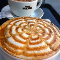 Photo taken at Caffé Nero by Haldun S. on 5/6/2012