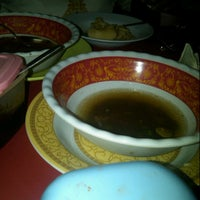 Photo taken at Warung Makan Sop Iga Sapi Bambu Kuning by Dedy T. on 9/13/2012