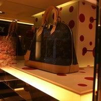 Photo taken at Louis Vuitton by Edwin G. on 8/11/2012