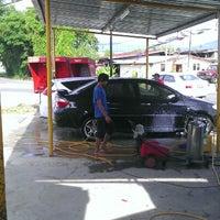 Photo taken at Car Wash Koperasi by Ryan E. on 7/28/2012