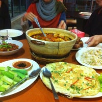 Photo taken at Nyonya Roots by Mike N. on 8/25/2012
