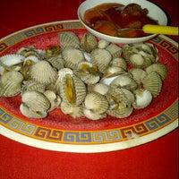 Photo taken at Seafood 98 Nasi Uduk by ika l. on 2/29/2012