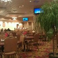 Photo taken at Sahara Restaurant & Grill by Jason on 2/10/2012