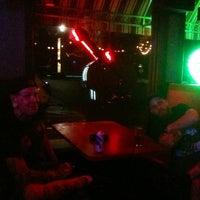 Photo taken at Odin's Den by Jennifer D. on 4/23/2012