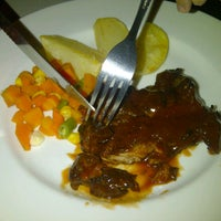 Photo taken at Obonk steak & ribs by Liz S. on 8/26/2012