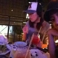 Photo taken at Genius Lounge and Sake Bar by Anastasia L. on 10/3/2011