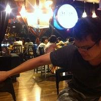 Photo taken at Umami Cafe by Denis K. on 3/14/2011