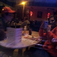Photo taken at Basile's Italian Restaurant and Pizzeria by Sara B. on 3/31/2012
