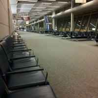 Photo taken at Concourse D by Tina D. on 8/20/2011