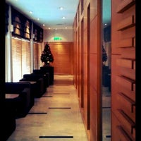 Photo taken at PURA INDAH First & Business Class Lounge by Jes H. on 12/28/2011