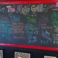 Photo taken at The Mojo Grill by Chris G. on 8/17/2011