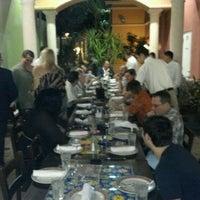 Photo taken at Tarantella Ristorante & Pizzeria by Vinny F. on 2/1/2012