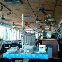 Photo taken at Cracked Conch Cafe by Bobbie B. on 11/30/2011