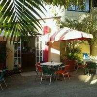 Photo taken at Mango cafe by Astrid V. on 12/1/2011