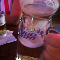 Photo taken at Bison's Bar and Grill by Erica F. on 7/30/2011