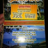 Photo taken at Jerkfish Jamaican Restaurant by Darren R. on 8/9/2011