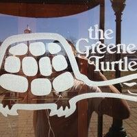 Photo taken at The Greene Turtle by Erik B. on 11/18/2011
