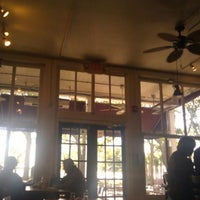 Photo taken at Plums Restaurant by Brittany C. on 11/2/2011