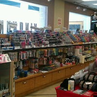 Photo taken at Kinokuniya Bookstore by Liz G. on 7/24/2012
