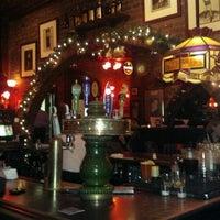 Photo taken at John D. McGurk's Irish Pub by Tim J. on 12/21/2011