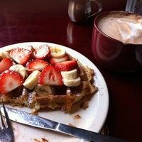 Photo taken at Iguana Café by Kevin K. on 10/1/2011