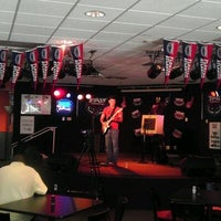 Photo taken at Burrow Bar & Grill by Arnold D. on 10/25/2011