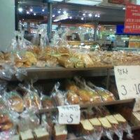 Photo taken at Gateaux Bakery & Cafe by Strawberry B. on 10/26/2011