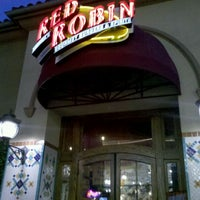 Photo taken at Red Robin Gourmet Burgers by Ana D. on 2/26/2012