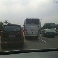 Photo taken at Gerbang Tol Taman Mini Utama by Yulius E. on 5/24/2012
