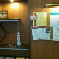 Photo taken at Restaurant & Bar FRONTIER (フロンティア) by Katsuhiro S. on 12/4/2011