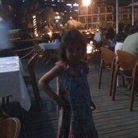 Photo taken at Palm beach by İpek E. on 7/7/2012
