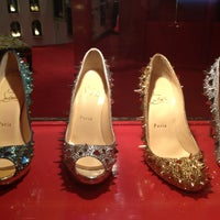 Photo taken at Christian Louboutin by Joanna A. on 8/4/2012