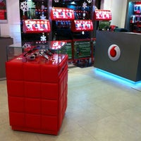 Photo taken at Vodafone Store by Erika M. on 12/21/2011