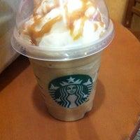 Photo taken at Starbucks by masseni c. on 8/6/2011