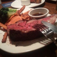 Photo taken at Outback Steakhouse by Ali K. on 11/29/2011
