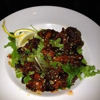 Photo taken at The Rack Sushi Bar & Billiards Lounge by Christina K. on 7/15/2012