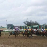 Photo taken at Fair Grounds Race Course & Slots by Katie R. on 1/27/2012