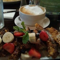 Photo taken at Blu Jam Café by Shelya J. on 11/7/2011